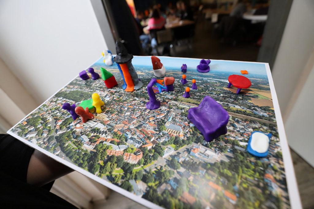 Bild von Münster von oben mit Spielfiguren